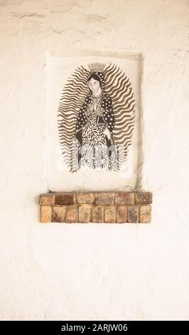 This area is known as La Candelaria, one of Bogota hot spots where there are many murals and graffiti. Virgin Mary mural on a church wall. - Stock Photo