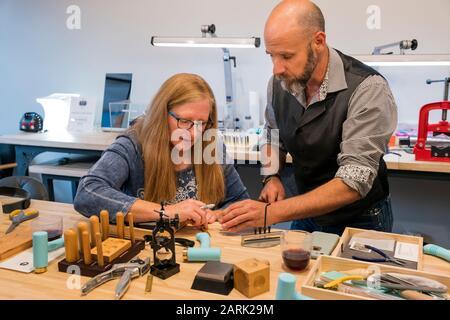 Customers learn to craft jewelry; Riveting Experience Jewelry; Salida; Colorado; USA