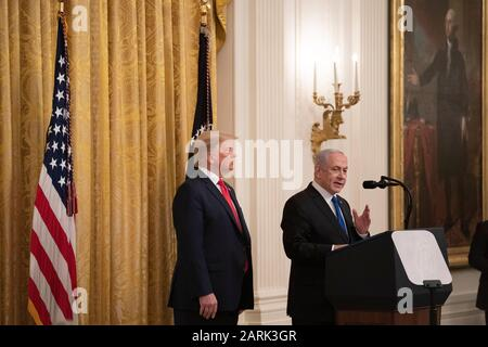 Washington, USA. 28th Jan, 2020. U.S. President Donald Trump (L) and Israeli Prime Minister Benjamin Netanyahu attend a joint press conference in the White House in Washington, DC, the United States, on Jan. 28, 2020. U.S. President Donald Trump on Tuesday revealed the long-awaited political aspect of his controversial Middle East peace plan, calling for a two-state solution while recognizing Jerusalem as Israel's 'undivided capital.' Credit: Liu Jie/Xinhua/Alamy Live News - Stock Photo