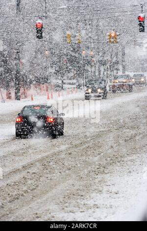 New England blizzard conditions on a crowded suburban road - Stock Photo