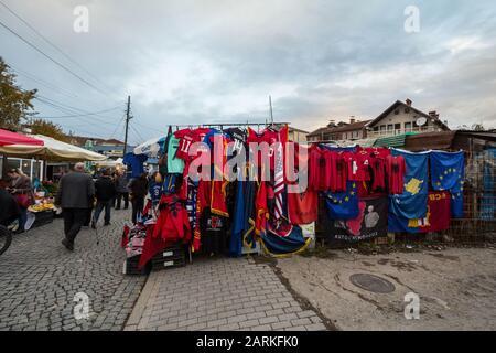 PRISHTINA, KOSOVO - NOVEMBER 11, 2016: Stall on the Prishtina market with albanian flags and other national items for sale. Pristina is the Kosovan ca - Stock Photo