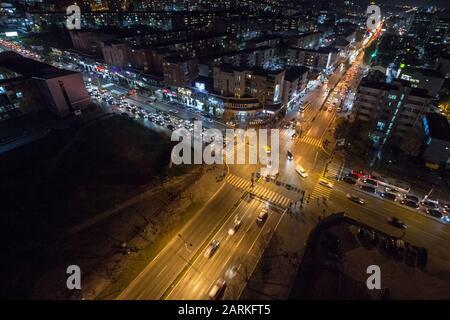 PRISHTINA, KOSOVO - NOVEMBER 11, 2016: Night view of the Crossroad between Bill Clinton Boulevard and George W Bush Bd with cars passing Pristina is K - Stock Photo