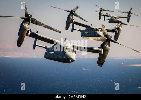U.S. Marines with Marine Medium Tiltrotor Squadron (VMM) 364, attached to Special Purpose Marine Air-Ground Task Force-Crisis Response-Central Command, fly multiple MV-22 Ospreys during a simulated air-raid as part of the Middle East Amphibious Commanders Symposium, Sept. 24, 2019. The SPMAGTF-CR-CC is a multiple force provider designed to employ ground, logistics, and air capabilities throughout the Central Command area of responsibility. (U.S. Marine Corps photo by Sgt. Branden Bourque) - Stock Photo