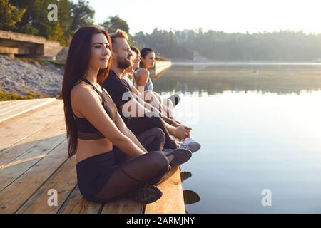 Group of people resting relax in the park by the lake Stock Photo