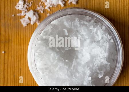 Salt flakes in jar - top view photo of Cypriot salt close up - Stock Photo