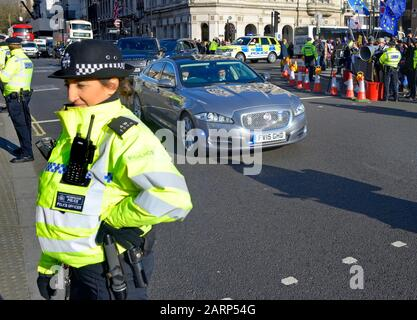 London, UK. 29th Jan, 2020. Prime Minister Boris Johnson arrives at Parliament for Prime Minister's Questions, surrounded by a heavy police presence and anti-Brexit protesters. Credit: PjrFoto/Alamy Live News - Stock Photo