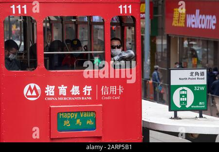 Hong Kong, China. 29th Jan, 2020. Fear of the 2019 Novel Coronavirus from Wuhan China is evident on the streets of Hong Kong with people traveling on the famous trams with surgical masks Credit: Jayne Russell/Alamy Live News - Stock Photo