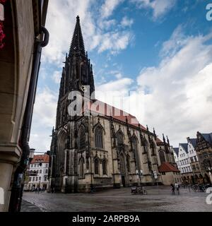 Low angle view of the Lambertikirche (St. Lambert's Church) in the side streets of the old centre of Munster in Westphalia, North-West Germany. - Stock Photo