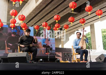 Capital Federal, Buenos Aires / Argentina; Jan 25, 2020: new dynasty duo, young musicians performing traditional Chinese musical instruments: erhu and - Stock Photo