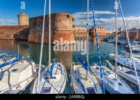 Sailboats at port, bastions of Fortezza Vecchia (Old Fortress), medieval fort in Livorno, Tuscany, Italy - Stock Photo