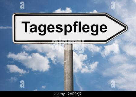 Detail photo of a signpost with the inscription Tagespflege (Day care) - Stock Photo