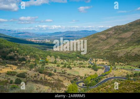 San Lorenzo del Escorial from La Cruz Verde mountain pass. Robledo de Chavela, Madrid province, Spain. - Stock Photo