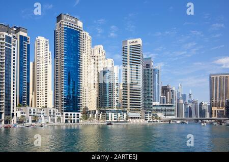 DUBAI, UNITED ARAB EMIRATES - NOVEMBER 23, 2019: Dubai Marina modern skyscrapers and sea in a sunny day, blue sky in Dubai