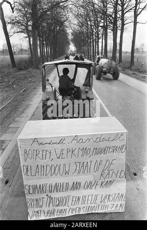 Demonstration of Belgian farmers with tractors on the road of the Netherlands  Tractor with banner during the action Date: 19 March 1971 Location: Belgium Keywords: demonstrations, farmers, banners, tractors - Stock Photo