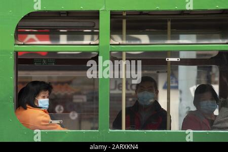 Hong Kong, China. 29th Jan, 2020. People wear masks on the West bound tram in Causeway Bay. The government has recommended that people across China wear face masks. Credit: Jayne Russell/ZUMA Wire/Alamy Live News - Stock Photo