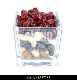 Bowl with different dried fruits and nuts on white background - Stock Photo