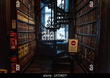 DUBLIN, IRELAND, DECEMBER 21, 2018: The Long Room in the Trinity College Library,home to The Book of Kells. Perspective view of the place, with large - Stock Photo