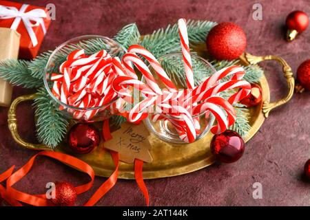 Composition with Christmas candy canes on table - Stock Photo
