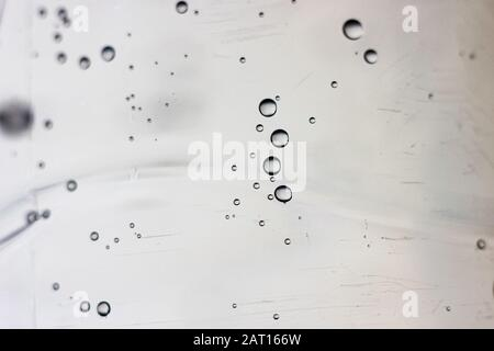 Bubbles in water on a gray background - Stock Photo