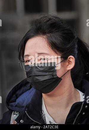 Face mask worn by a chinese student in Cambridge, England, on 30 january 2020, to prevent catching the coronavirus flu. - Stock Photo