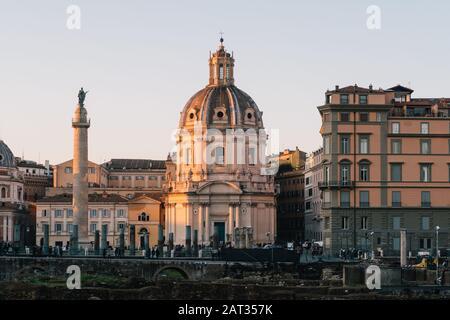 Rome, Italy - Jan 1, 2020: View across the ancient ruins of Trajan's Forum towards Trajan's Column and the Santa Maria di Loreto church in Rome, Italy Stock Photo