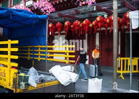 23.01.2020, Singapore, Republic of Singapore, Asia - Two men walk past the Buddha Tooth Relic Temple in the Chinatown district.