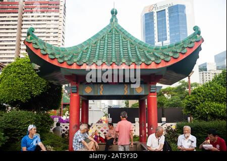 23.01.2020, Singapore, Republic of Singapore, Asia - People sit under a roof in the shape of a pagoda in a small public park in Chinatown.