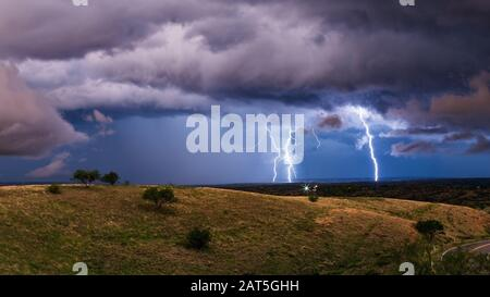 Vivid lightning strikes from a strong thunderstorm near Sonoita, Arizona. - Stock Photo