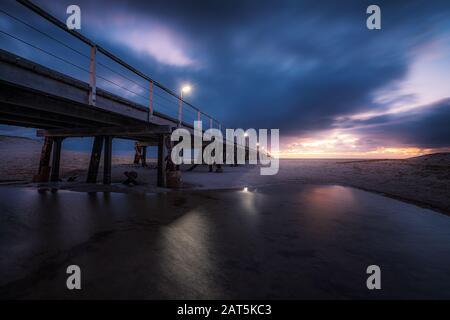 Sunset at Semaphore jetty, Adelaide, Australia - Stock Photo