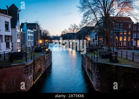 The center of Schiedam with beautiful narrow streets and small canals, photo taken in the evening hours with beautiful blue colors. Province south-Hol - Stock Photo