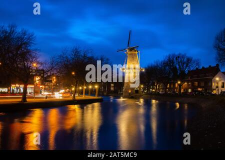 Beautiful windmills in Schiedam province South Holland, these highest windmills in the world also known as burner mills were used for grinding grain t - Stock Photo