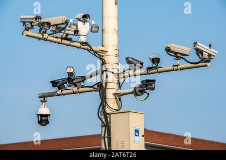 CCTV cameras on lantern pole in the capitol city of china Bejing. Concept of security, surveillance, being watched. - Stock Photo