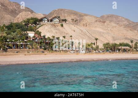 Eilat Mountains   meet the Red Sea at Coral Beach, Eilat on the Gulf of Aqaba - Stock Photo