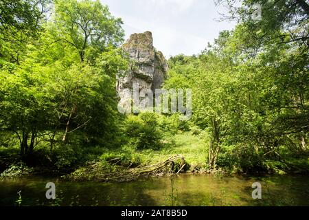 Jacob's Ladder rock seen across the River Dove, Dove Dale, Peak District National Park, Derbyshire and Staffordshire, England - Stock Photo