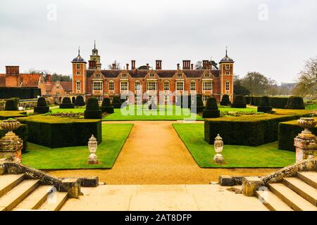 A photograph of Blickling Hall in Norfolk, taken looking across the formal gardens of the estate. - Stock Photo