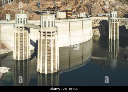 Boulder City, Nevada, United States: July 6 2009: Hoover Dam with Penstock Water Inlet Towers. A Concrete Arch Gravity Dam. - Stock Photo