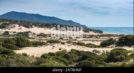 Dune di Piscinas, Hotel Le Dune on right, near Spiaggia Piscinas beach, Arburese mountain range in distance, Costa Verde, Sardinia, Italy - Stock Photo