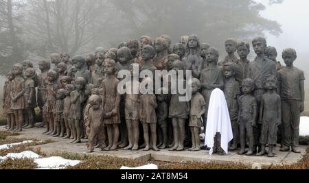 +++FILE PHOTO+++  Newly casted bronze sculpture of a girl was set into Lidice memorial of children victims of the war on January 16, 2011 in Lidice, Czech Republic. Original sculpture was stolen last year in November. ......Ten out of the 16 managers and experts from the Lidice Memorial have resigned January 31, 2020, saying that after the former director Martina Lehmannova stepped down from her post last week in Lidice, Czech Republic, January 21, 2020, the memorial will be in the grips of a Communist-like interpretation of history. Lehmannova resigned after facing criticism from some of the - Stock Photo