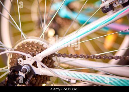 Bicycle's detail view of rear wheel with chain sprocket - Stock Photo