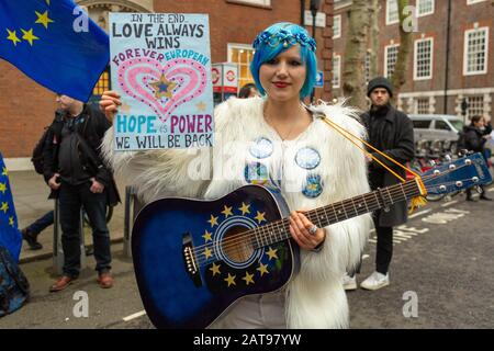 Westminster, UK. 31st Jan, 2020. EU Supergirl. Pro Europe rally, with Bollox to Brexit minis  outside Europe House, Westminster. - Stock Photo