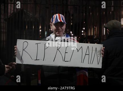 London, UK. 31st Jan, 2020. A Brexit supporter celebrate holds a placard outside No.10 Downing St as the Uk prepare to leave the European Union at 11 pm tonight in London on Friday, December 31, 2020. Photo by Hugo Philpott/UPI Credit: UPI/Alamy Live News
