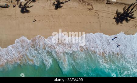 Aerial view of bright blue water and surf with waves crashing at Bonzai Pipeline and Sunset Beach Park on North Shore, Haleiwa, Oahu, Hawaii, USA. - Stock Photo