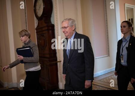 Beijing, USA. 31st Jan, 2020. U.S. Senate Majority Leader Mitch McConnell (C) heads to the Senate Chamber before the start of the Senate impeachment trial on Capitol Hill in Washington, DC, the United States, on Jan. 31, 2020. Credit: Liu Jie/Xinhua/Alamy Live News - Stock Photo