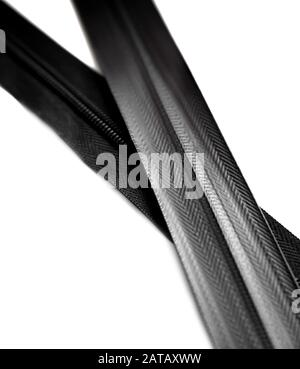 Black waterproof zipper closeup isolated on white background - Stock Photo