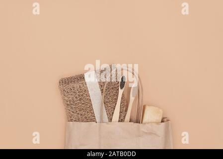 Zero waste bathroom accessories, natural sisal brush, wooden comb, deodorant, shea butter, solid soap and shampoo bars, reusable cotton make up remova - Stock Photo