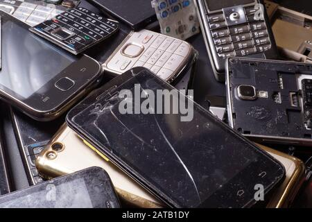 Electronic scrap. Different phones and smartphones not suitable for repair. - Stock Photo