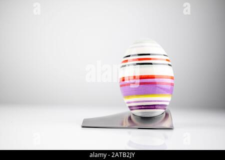 Happy Easter! Easter Egg in an eggcup for breakfast, egg in eggcup for easter breakfast - Stock Photo