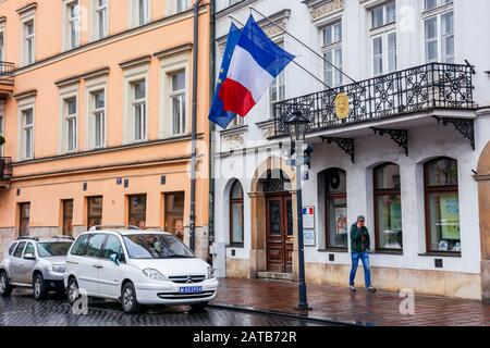 Krakow, poland - APR 30, 2019: France and EU flags on facade of Consulate General of the Republic of France in Krakow located in historic center of an - Stock Photo