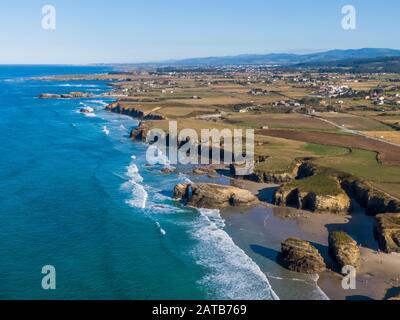 Aerial view of As Catedrais beach or Praia de Aguas Santas in Galicia - Stock Photo