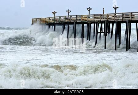Huge Hurricane Florence Wave Crashing on Pier in North Carolina - Stock Photo